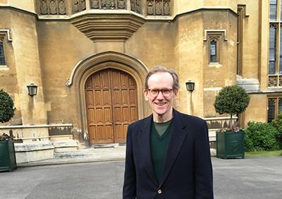J. Chester Johnson at the main entrance to Lambeth Palace, London, England